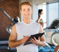 Lifestyle Fitness Coaching Certification Professional holding a clipboard