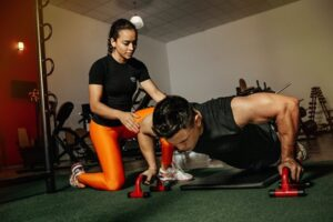 a personal fitness trainer guiding her client