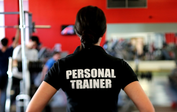 A personal trainer ready to train a client