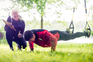 : A personal trainer helping a client